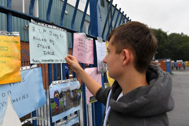 Messages from supporters placed on a fence outside Bury's Gigg Lane stadium