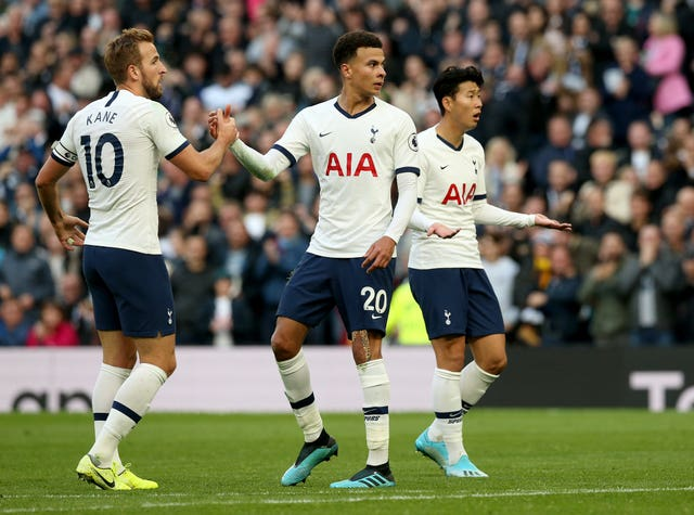 Dele Alli (centre) celebrates his equaliser