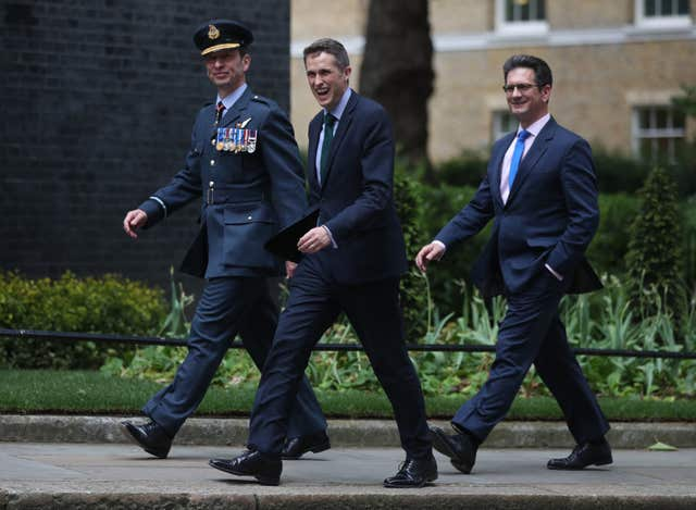 Defence Secretary Gavin Williamson (centre) arrives in Downing Street (Jonathan Brady/PA)