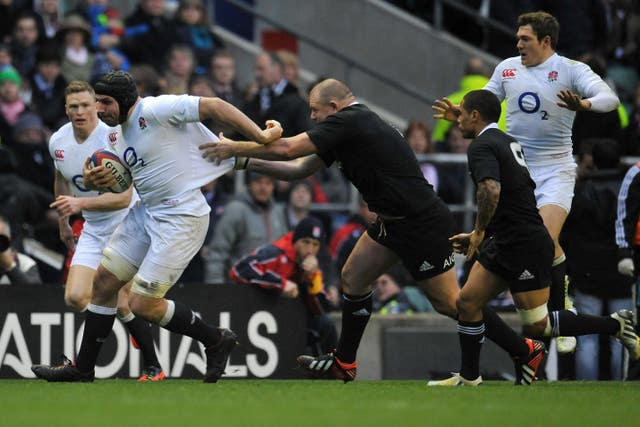 England's Ben Morgan runs with the ball
