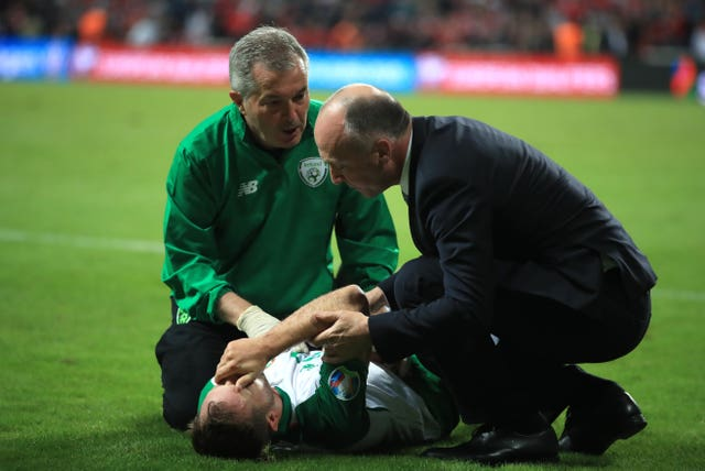Alan Judge receives treatment on the pitch after breaking his wrist in Denmark