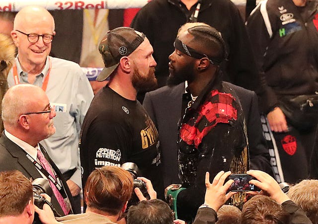 Joshua believes a showdown between Tyson Fury, left, and Deontay Wilder, right, is good for boxing (Niall Carson/PA)