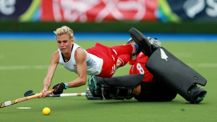 Alex Danson-Bennett dives over a goalkeeper to shoot