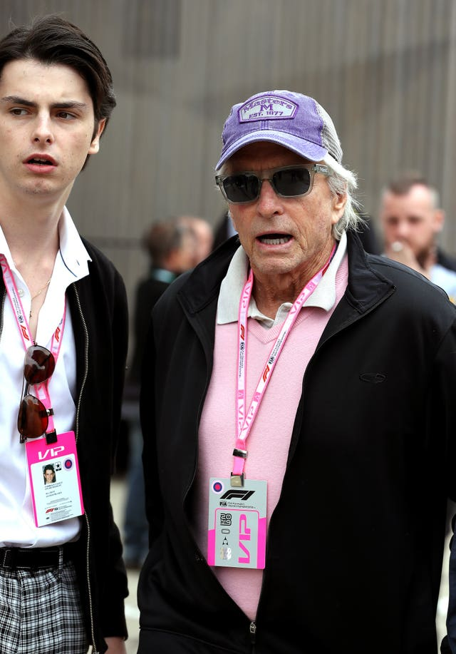 Dylan Michael Douglas, left, and Michael Douglas arrive during the British Grand Prix at Silverstone