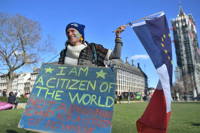 A woman takes part in the One Day Without Us rally in London