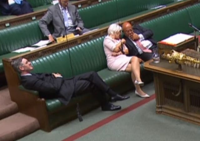 Leader of the House of Commons Jacob Rees-Mogg reclining on his seat in the House of Commons London