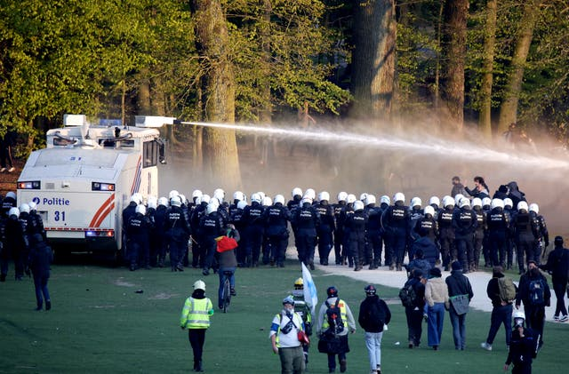 Police use a water cannon in Bois de la Cambre park