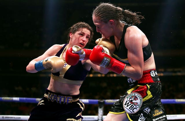 Katie Taylor, left, lands a punch against Delfine Persoon