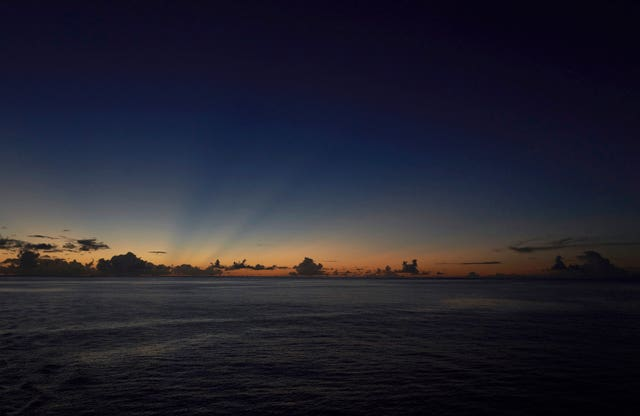 The last rays of sunlight cross the sky after sunset off the Seychelles