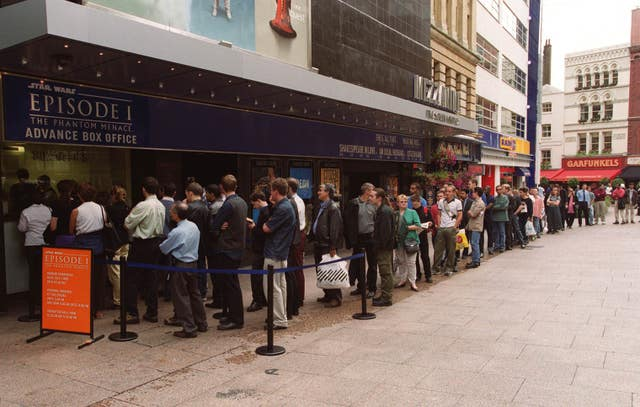 Star Wars fans queue outside the Odeon Leicester Square cinema in London on the opening day of Star Wars: The Phantom Menace in 1999