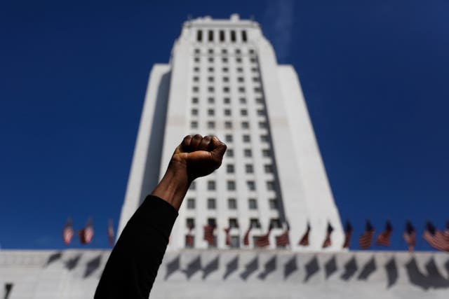 A protester holds up his fist while chanting a slogan during a protest over the death of George Floyd
