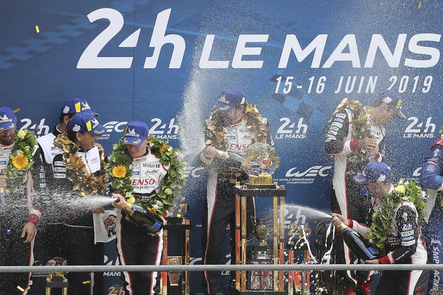 Fernando Alonso celebrates his second successive Le Mans 24 win with teammates