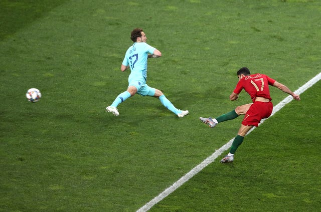 Goncalo Guedes, right, fires Portugal's winner in the Nations League final