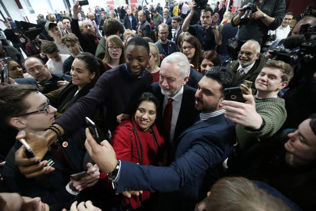 Labour leader Jeremy Corbyn poses for selfies with supporters after he delivered his major speech on Brexit. (Aaron Chown/PA)