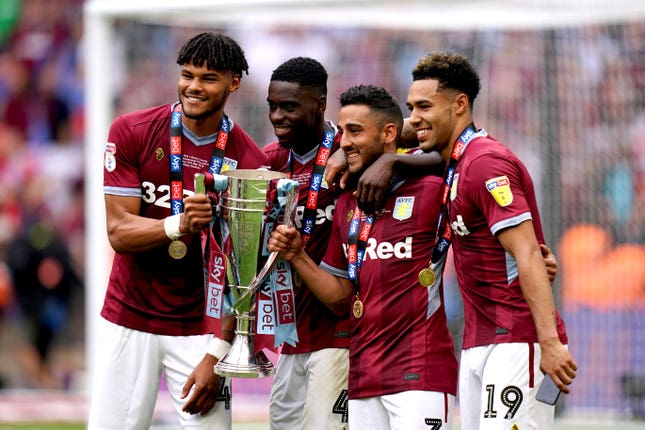 Mings (far left), was a key player in Aston Villa's 2018-19 return to the Premier League