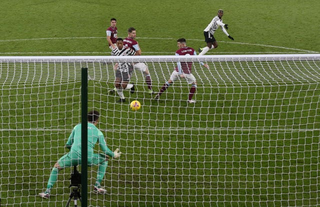 Paul Pogba, top, turns away in anticipation as his volley deflects off Matt Lowton, second right, for the only goal
