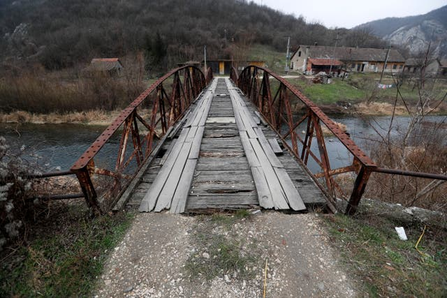 A dilapidated bridge close to an abandoned factory is seen near the town of Kucevo, Serbia
