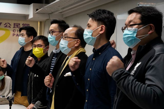 Pro-democratic party members shout slogans in response to the mass arrests during a press conference in Hong Kong