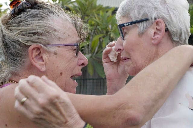 Christine Archer, right, and her sister Gail Baker are reunited