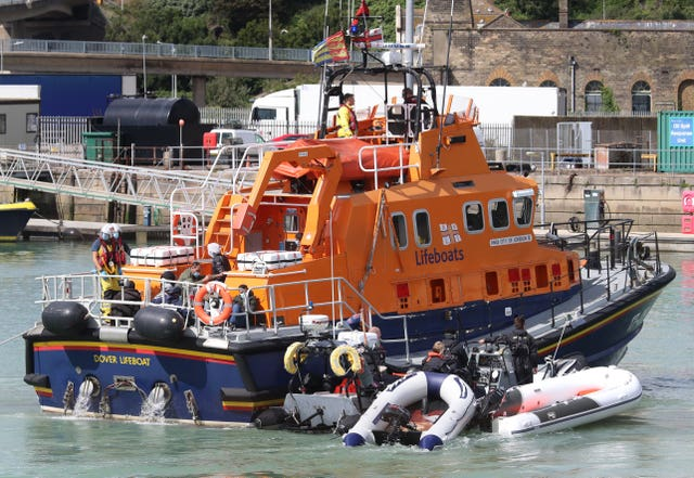 The Dover Lifeboat and Border Force officers tow small boats into Dover, Kent (Gareth Fuller/PA)