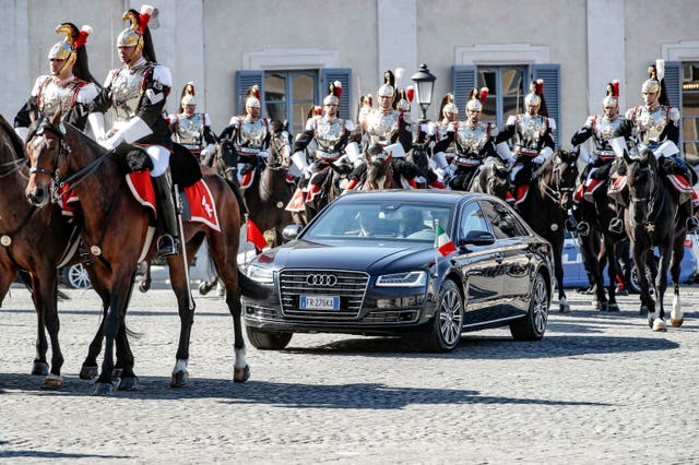 Xi Jinping and his wife Peng Liyuan arrive at the Quirinale Presidential Palace in Rome