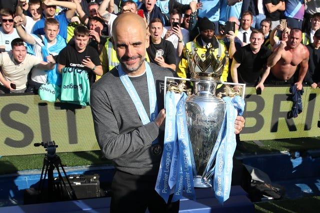 Pep Guardiola celebrates last season's title success
