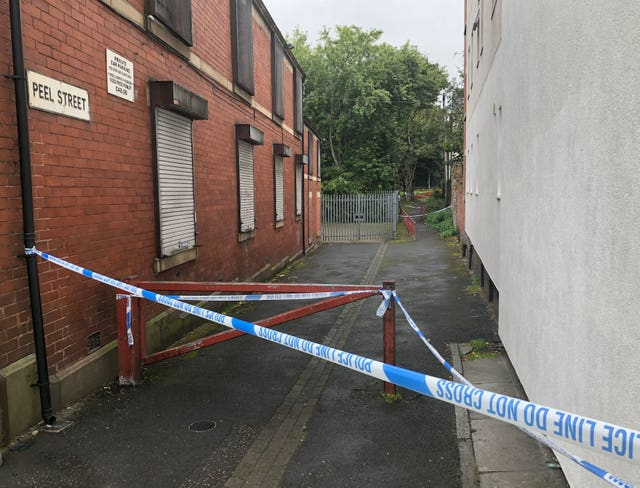 A police cordon in place on Peel Street in Radcliffe