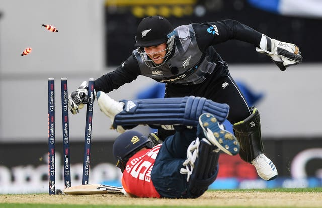 New Zealand wicket keeper Tim Seifert (right) whips the bails off as he runs out England batsman Sam Curran during their T20 cricket match at Eden Park