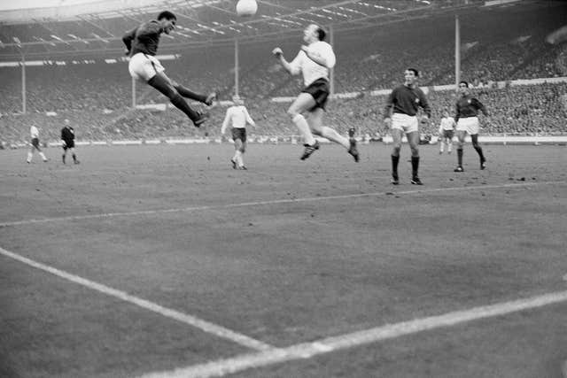 Eusebio and Nobby Stiles go head to head during England's 1966 semi-final win over Portugal