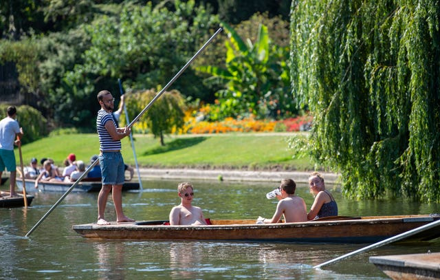 People punt along the River Cam in Cambridge