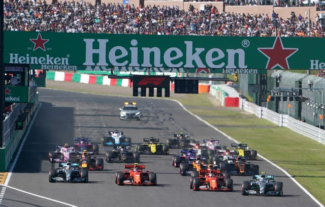 Valtteri Bottas, right, passes Sebastian Vettel, second right,  off the start line