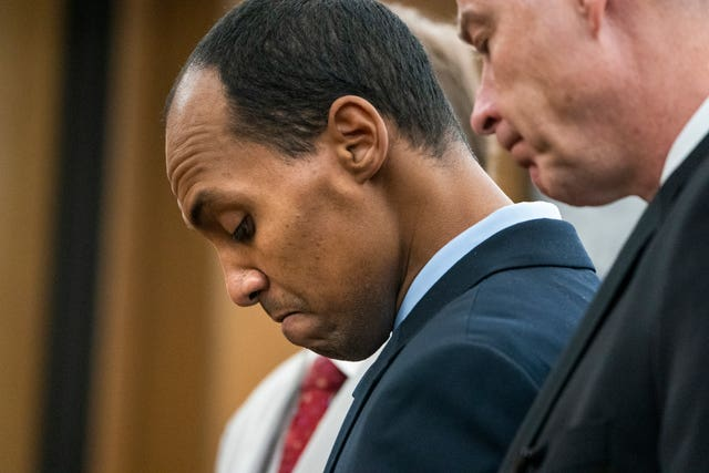 Mohamed Noor reads a statement in court