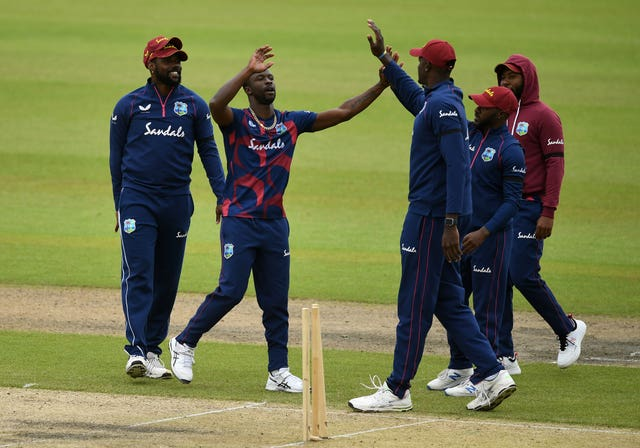 Kemar Roach, second left, will attempt to exploit an England batting line-up light on experience (Gareth Copley/PA)