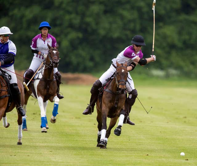 The Duke of Cambridge, right, about to take a shot (Steve Parsons/PA)