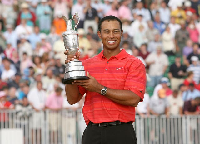 Open Champion Tiger Woods with the 135th Open Championship trophy in 2006