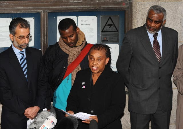 Stephen Lawrence's mother Doreen Lawrence alongside Stephen's father Neville, right, and brother Stuart, second left, outside the Old Bailey in 2012