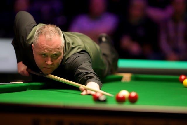John Higgins enjoyed a straightforward win