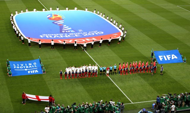 Both teams line up on the pitch ahead of the semi-final