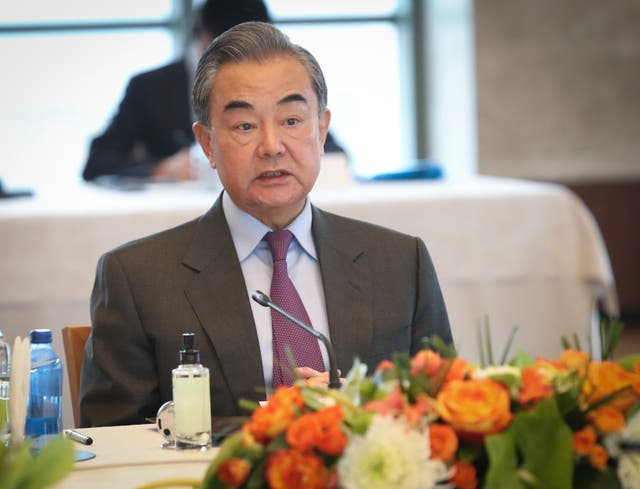 China's foreign minister Wang Yi talks during a meeting with Turkey's foreign minister Mevlut Cavusoglu, in Ankara (AP)