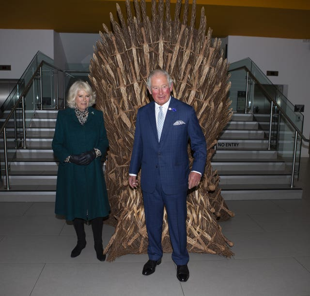 Charles and Camilla view a throne made for the party at the end of filming of Game of Thrones by local man Bob Johnson. Ian Vogler/Daily Mirror