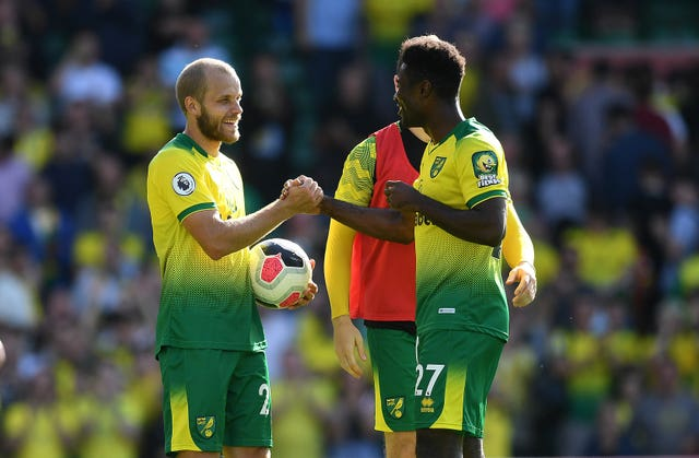 Teemu Pukki, left, scored a hat-trick as Norwich secured their first win since returning to the Premier League