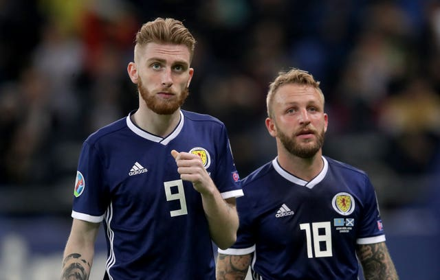 Scotland's Oliver McBurnie, left, and Johnny Russell, right, appear in shock