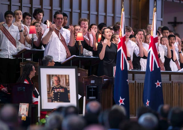 A choir sings during the national memorial service