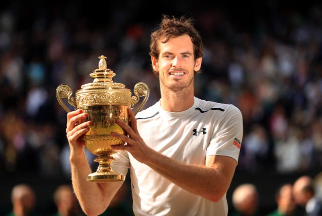 Andy Murray holds the Wimbledon trophy for the second time