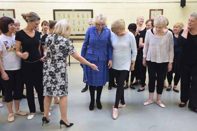 The Duchess of Cornwall with Elaine Paige and Angela Rippon as Camilla learns to do a tendu at the Royal Academy of Dance in London (Eddie Mulholland/Daily Telegraph/PA)