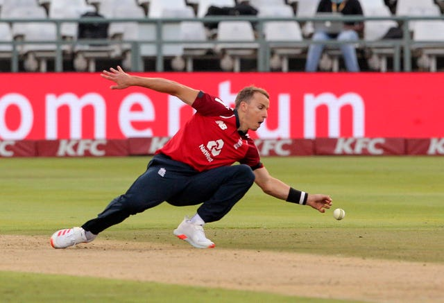 England bowler Tom Curran fields the ball off his own bowling