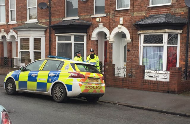 Police officers outside a house on Raglan Street in Hull