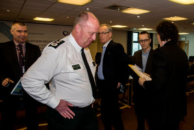PSNI Chief Constable George Hamilton, second from left, and Sinn Fein Policing Board member Gerry Kelly, centre
