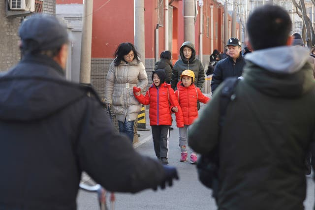 Children are escorted from the site