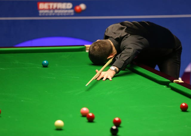 Ronnie O'Sullivan reacts after missing a pot